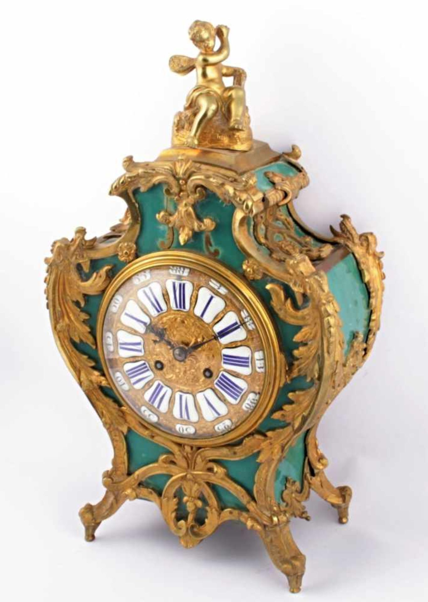 Los 26 - French table clock France, 19th century, relief gold plated dial, enamel panels with numbers,