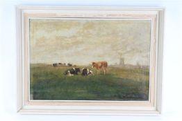 Schilderij op doek 'koeien in de wei', onduidelijk gesigneerd. HxB: 43.5 x 64 cm.