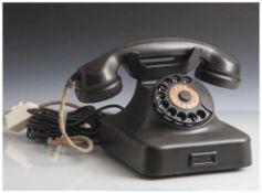 Altes Telefon mit Wählscheibe, wohl 1950/60er Jahre, rs. Herst. bez. Krone, schwarzes Gehäuse,
