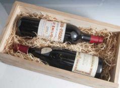 2 Flaschen Rotwein, darunter: a) Château-Figeac 1994, Premier Grand Cru Classé, St. Emilion, b)