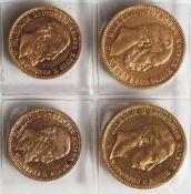 4 Goldmünzen Kaiserreich, darunter: a) 20 Mark 1897 A Preussen, b) 20 Mark 1873 C. c) 10 Mark 1888A,