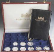 Konvolut von 9 Silbermünzen, Berliner Republik, versch. Motive u.a. das Bundeskanzleramt,