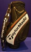A TAYLORMADE TM16 Tour Cart Golf Bag in Black/White/Red/Gold featuring 6-Way Velour Top (8.5 inch