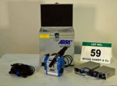 An ARRI Compact 125W Light with Associated Lease Ballast Power Supplies including Barn Doors and