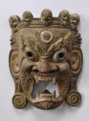 MAHAKALA-MASKE, wohl Burma, Holz, geschnitzt, gefasst, polychromiert, 39 x 29 cm