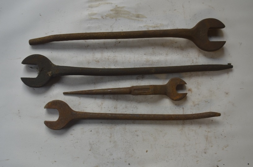 """Lot 22 - Four Podger spanners, length of longest approx. 19"""" (4)."""