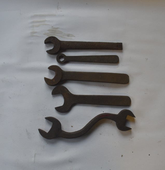 "Lot 3 - Four BSW - BSF spanners and a ring spanner, length of longest approx. 11 1/2"" (5)."