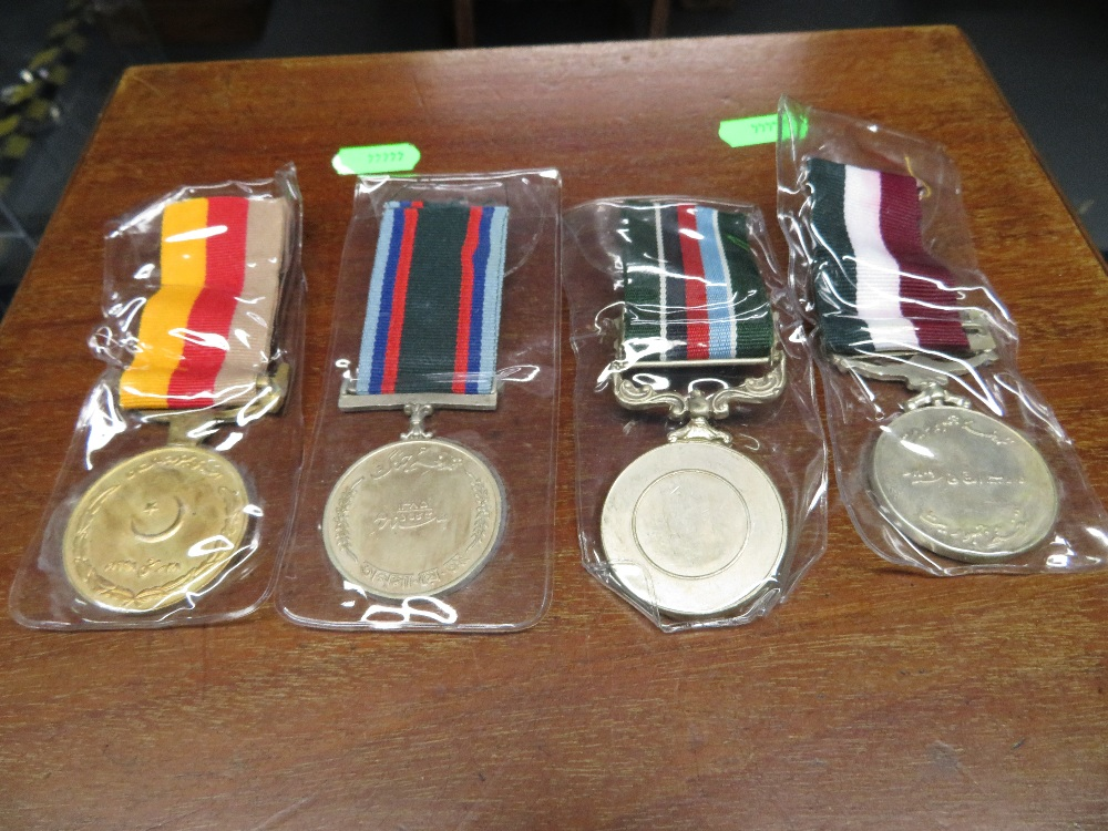 Lot 24 - Four Indian medals