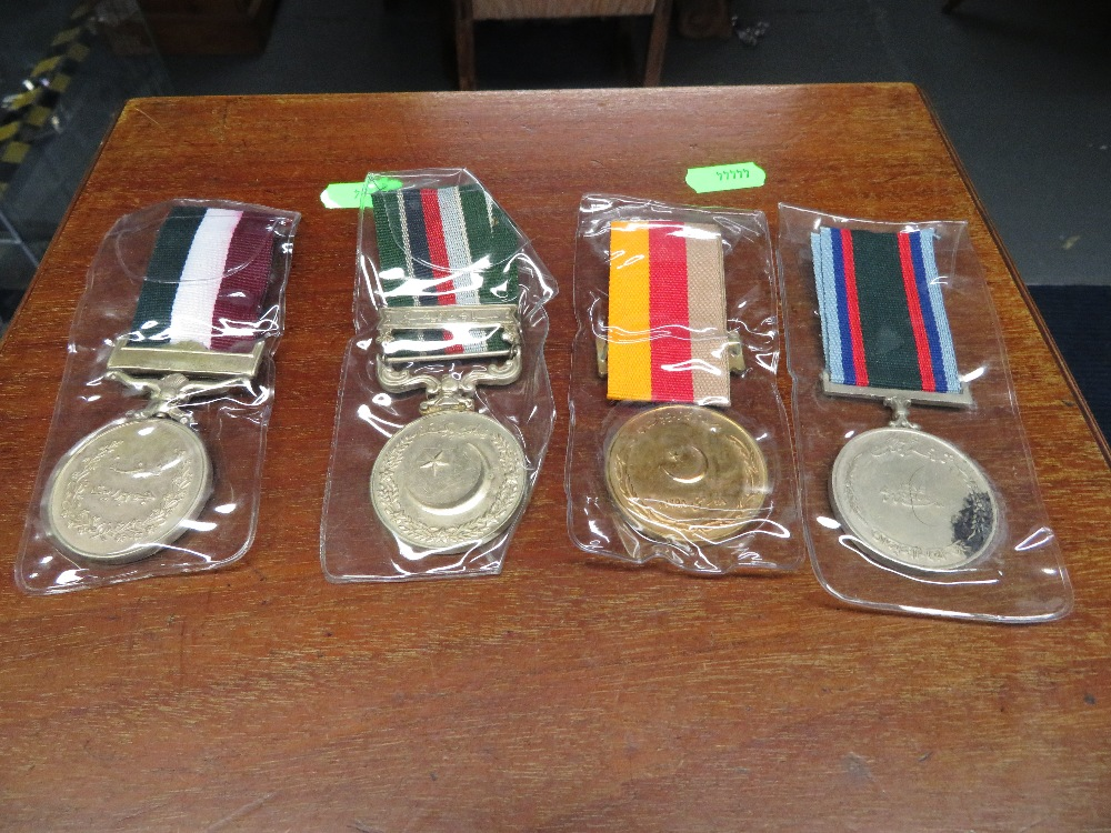 Lot 20 - Four Indian medals