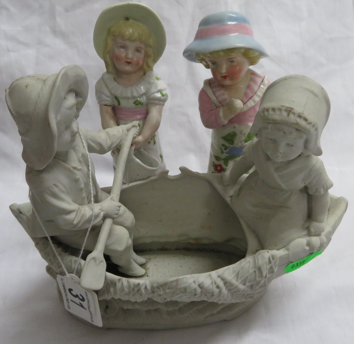 Lot 31 - Parian ware figures in a boat and two other figures - possibly German