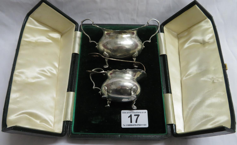 Lot 17 - Silver hallmarked milk jug, sugar bowl and tongs - boxed