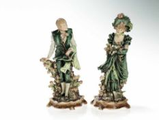 Two Art Nouveau Majolica Figures 'Lady and Gentleman', 1910/20 Hand-painted majolica with delicate