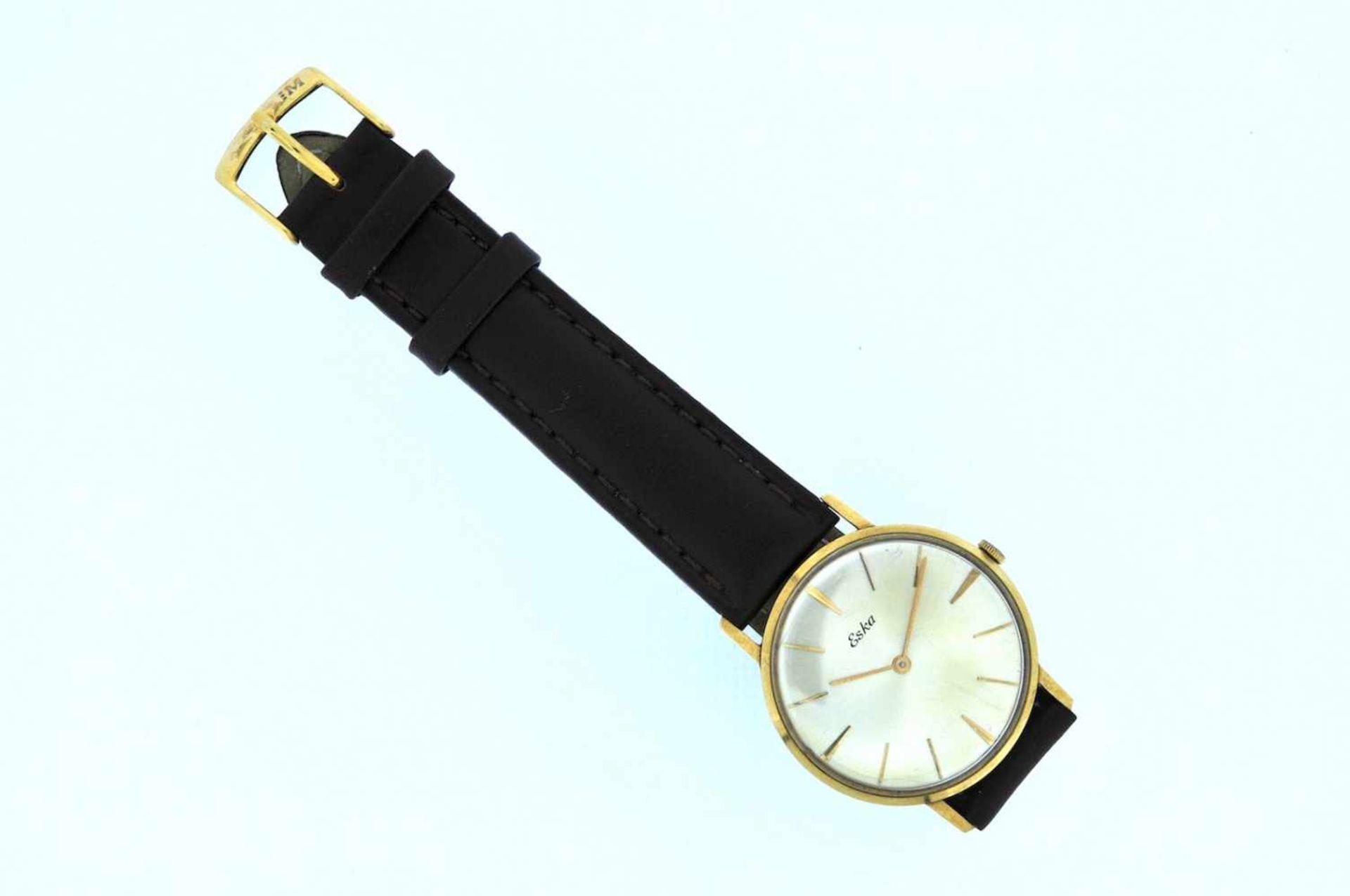Eska Goldene Armbanduhr an Lederband, Eska, Handaufzug, Ankerwerk, Werkservice empfohlen, 28,1 g.