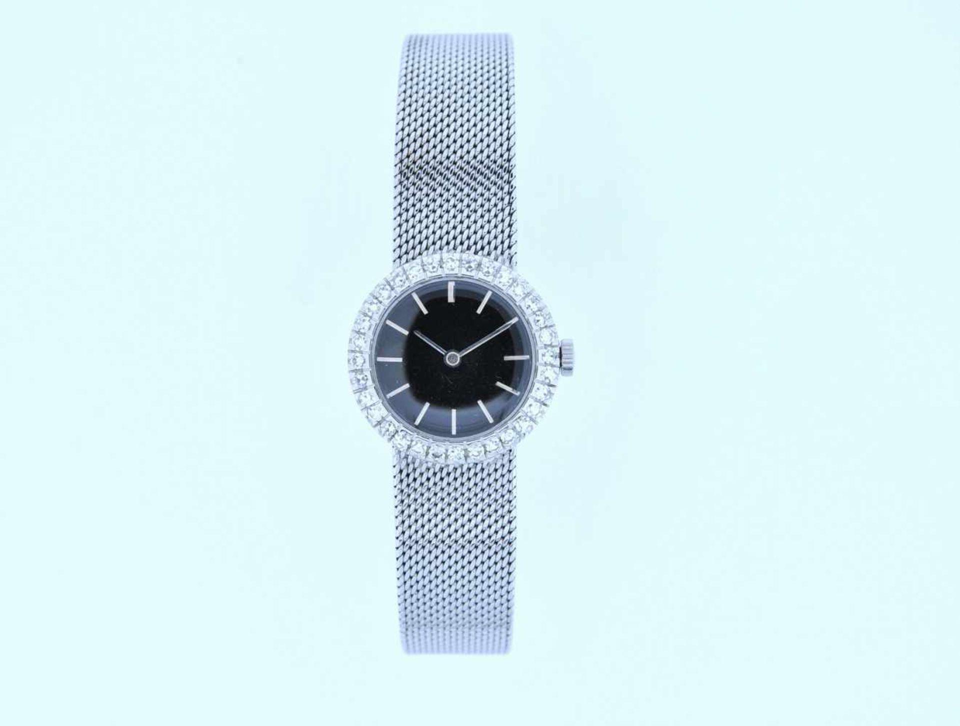 Los 12 - Damenuhr Weißgoldene Damenuhr mit Achtkantdiamanten, zus.ca. 0,5 ct, Handaufzug, Ankerwerk, Länge