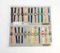 Swatch, 2 Displays mit 24 Uhren, Swiss made, neuwertig Swatch, 2 Displays wit 24 Watches, Swiss