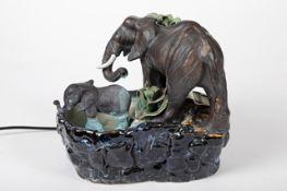 Zimmer-Springbrunnen Keramik, in figuraler Art ausgeführt, Elefanten mit Palme, 1.Hälfte 20.Jh.,