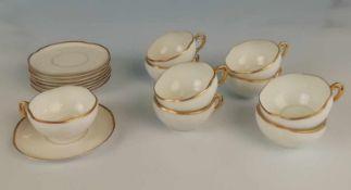 9 Kaffeetassen mit Untertassenweißes Porzellan, gold gerändert, Marke PL/S, 1 Tasse etwas