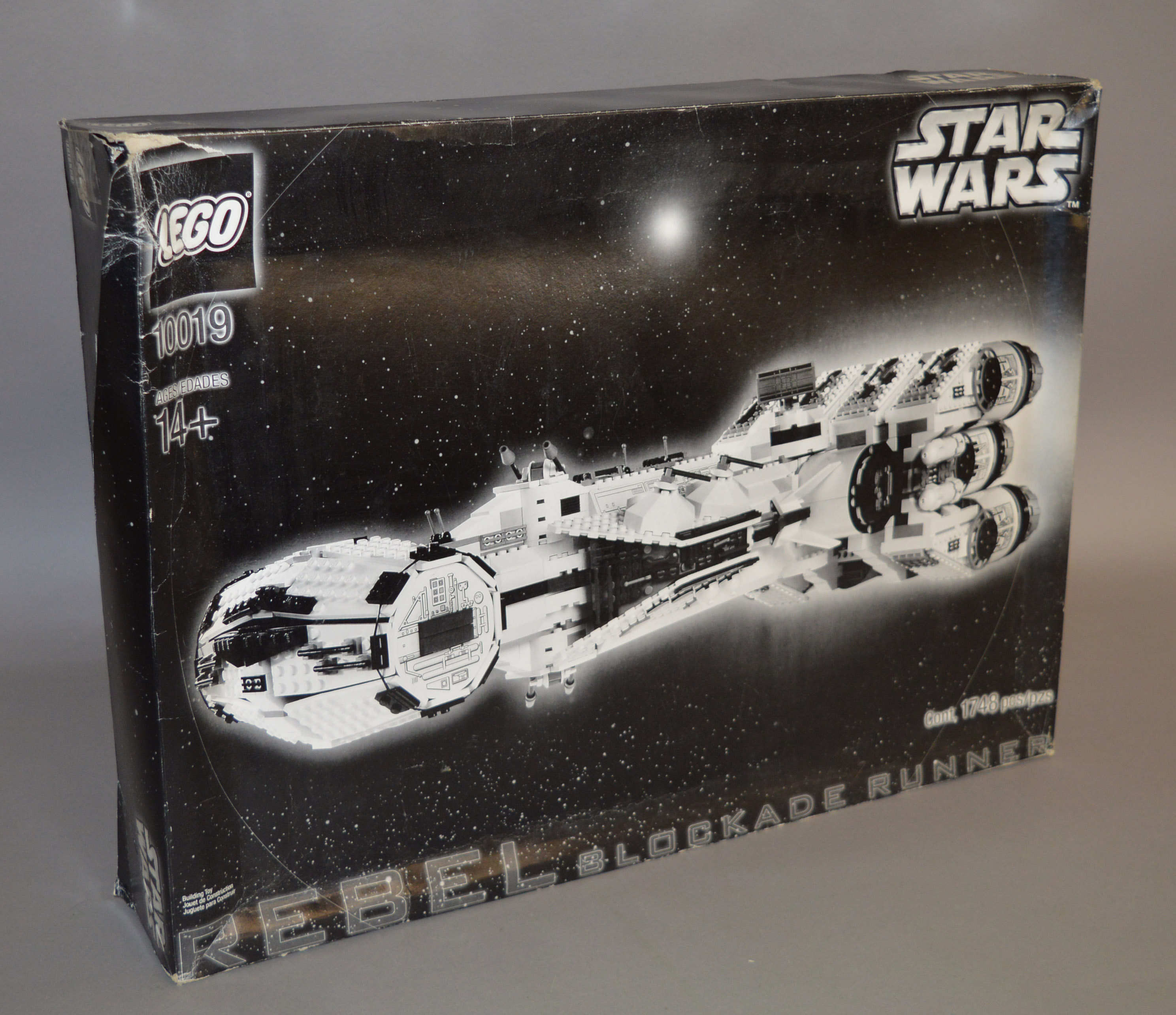 Lot 55 - Lego Star Wars 10019 'Rebel Blockade Runner', in F box with some tears, undulation and creasing.