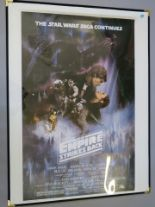 Lot 26 - Box of tubes of reproduction posters inc The Empire Strikes Back GWTW style,