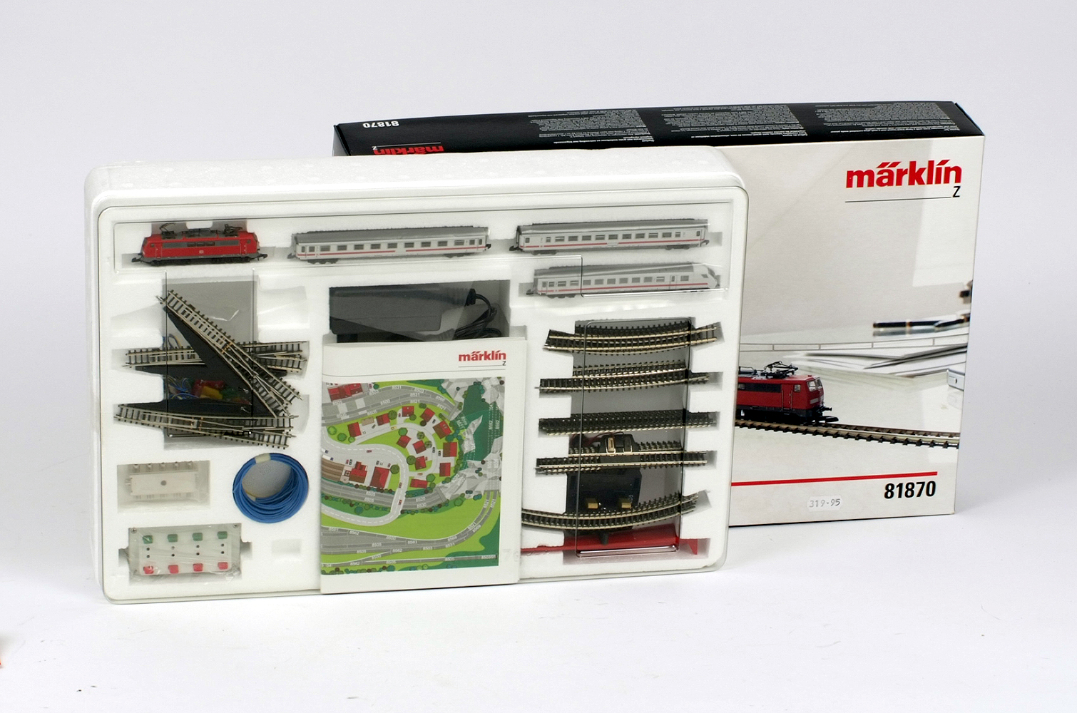 Lot 32 - Z gauge. Marklin 81870 train set, including locomotive, three coaches, track, accessories etc.