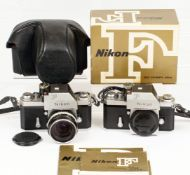 Two Nikon F Cameras with Photomic TN finders.