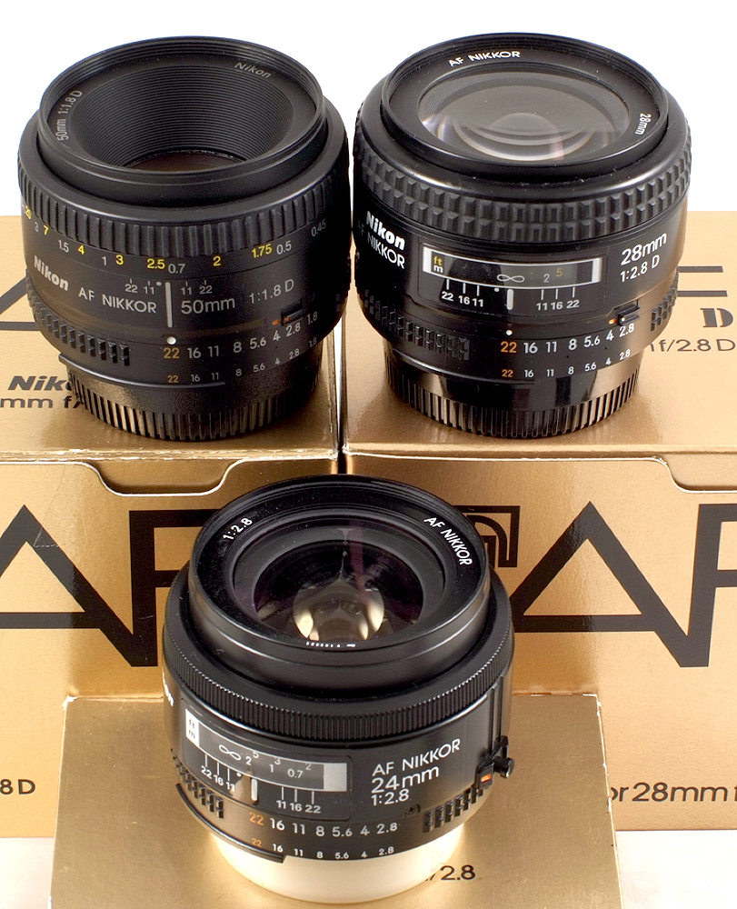 Lot 41 - Three Boxed Nikon Autofocus Lenses. Comprising Nikkor 28mm f2.8 D #453457; Nikkor 24mm AF 2.