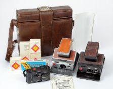 Two Polaroid SX-70 Instant Print Cameras.