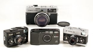 Four Good Quality Compact Film Cameras. Comprising Ricoh R1 with 30mm f3.