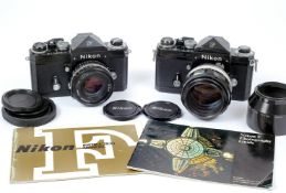Two Black Nikon F Cameras.