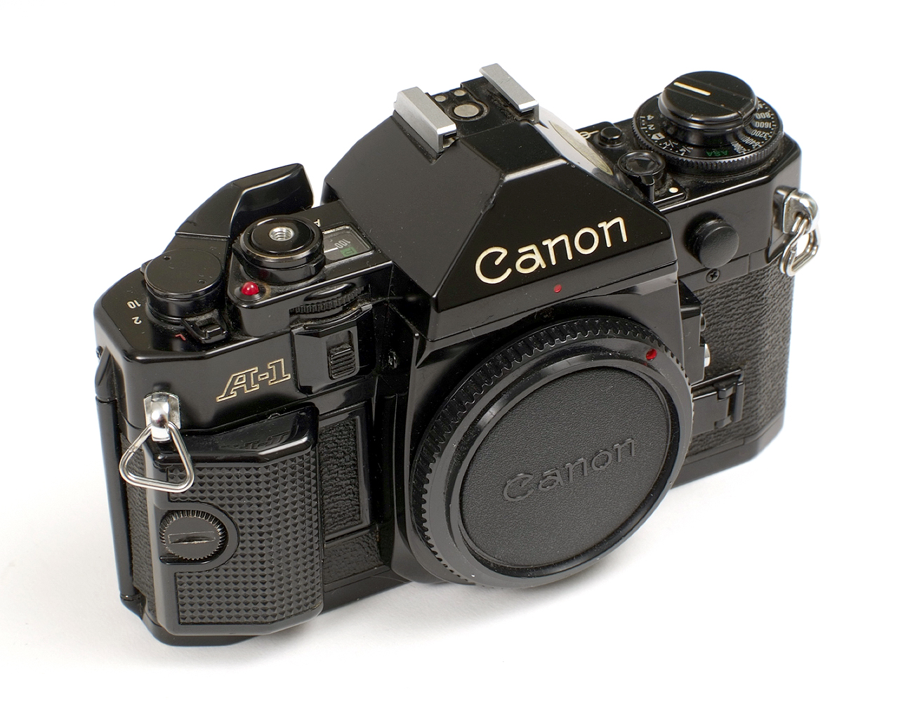 Lot 10 - A Canon A-1 Outfit in Metal Case.