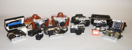 A Good box of Olympus & Other Collectors Cameras.