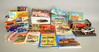 Nine boxed Tinplate models, including both friction and clockwork powered examples,