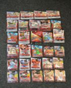 29 x Disney Pixar Cars 2 diecast models, including Deluxe models and twin packs. All carded, G-VG.