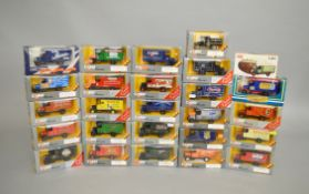 26 x Corgi diecast models, mostly Thornycroft Vans in grey window boxes. Boxed and E.