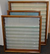 Three glass fronted wooden display cabinets, the largest of which measures approximately 96 x 80cm.
