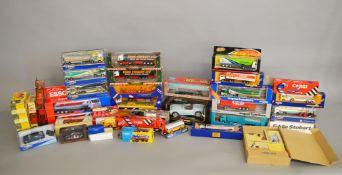 Fifty five boxed diecast models by Corgi, Lledo, Bburago and others, including 'Corgi Superhaulers',