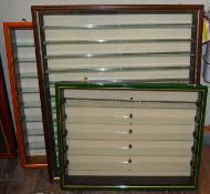 Three glass fronted wooden display cabinets, various frame types and sizes.