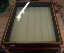 Three glass fronted wooden display cabinets, each in a similar size and style,