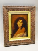 A Crystoleum - portrait of an attractive lady, with period frame. 27cm x 21cm.