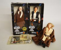 Two boxed Hasbro Star Wars large size action figures: Obi-Wan Kenobi; Han Solo.