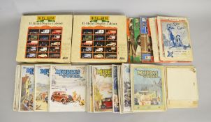 A collection of Morris Owner magazines, 1930's. Together with two Lledo wall display cabinets.