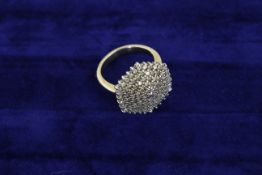 A large diamond cluster ring totalling appox 1.00ct in an unmarked gold mount, approx 6.