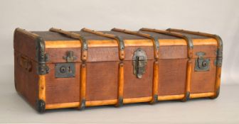A large wooden bound cabin / travelling trunk.
