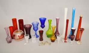 A mixed lot of glassware, mostly 20th Century, including vases, goblets and water jugs.
