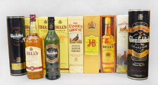 11 assorted bottles of Whisky: 5x Bell's, 3x Glenfiddich, 1x J&B, 2x Famous Grouse.