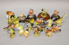 A collection of ceramic and resin bird figures including Beswick, Aynsley, Royal Adderley etc.