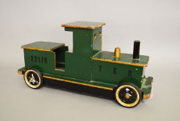 A well made pre-war wooden toy train. Repainted. Length approx 61cm.