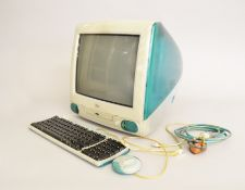 A 1998 Apple iMac computer with keyboard.