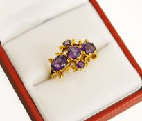 "A 9ct H/M yellow gold Amethyst set cluster ring, Makers mark ""AC.Co""."