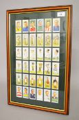 A framed and glazed collection of reproduction Worthington Best Bitter trading cards. Printed 1992.